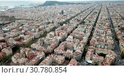 Купить «Aerial view of Barcelona cityscape with peculiar geometric grid of Eixample district», видеоролик № 30780854, снято 16 ноября 2018 г. (c) Яков Филимонов / Фотобанк Лори