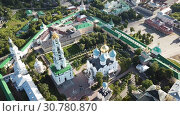 Купить «View from drones of churches in Trinity Lavra of St. Sergius Monastery, Sergiyev Posad», видеоролик № 30780870, снято 28 июня 2018 г. (c) Яков Филимонов / Фотобанк Лори