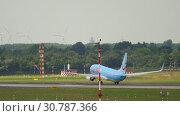 Купить «TIUfly Boeing 737 departure», видеоролик № 30787366, снято 22 июля 2017 г. (c) Игорь Жоров / Фотобанк Лори