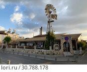 Купить «Ресторан с ветряком на набережной Средиземного моря в Ларнаке», фото № 30788178, снято 10 мая 2019 г. (c) Irina Opachevsky / Фотобанк Лори