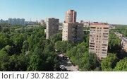 Купить «The Cityscape in Khimki city from above. Russia», видеоролик № 30788202, снято 21 мая 2019 г. (c) Володина Ольга / Фотобанк Лори