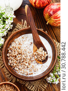 Купить «Buckwheat porridge with milk i», фото № 30788442, снято 13 мая 2019 г. (c) Надежда Мишкова / Фотобанк Лори
