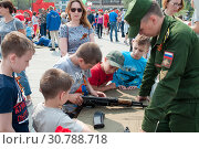 Купить «Tyumen, Russia, on May 9, 2019: The Russian children are interested in types of firearms», фото № 30788718, снято 9 мая 2019 г. (c) Землянникова Вероника / Фотобанк Лори