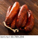 Купить «Chorizo on wooden surface», фото № 30789294, снято 23 июля 2019 г. (c) Яков Филимонов / Фотобанк Лори
