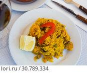Купить «Appetizing seafood dish Paella with shrimp. Spanish cuisine», фото № 30789334, снято 21 ноября 2019 г. (c) Яков Филимонов / Фотобанк Лори