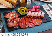 Купить «Slices of gammon, chorizo, salami, bacon on slate board», фото № 30789378, снято 18 июля 2019 г. (c) Яков Филимонов / Фотобанк Лори