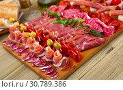 Купить «Cold cuts from Spanish ham, sausages, bacon», фото № 30789386, снято 22 мая 2019 г. (c) Яков Филимонов / Фотобанк Лори