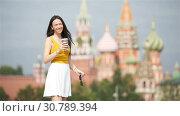 Купить «Happy young urban woman in european city.», видеоролик № 30789394, снято 4 августа 2018 г. (c) Дмитрий Травников / Фотобанк Лори