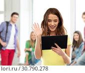 teenage girl having video call on tablet computer. Стоковое фото, фотограф Syda Productions / Фотобанк Лори