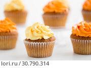 Купить «close up of cupcakes with buttercream frosting», фото № 30790314, снято 6 июля 2018 г. (c) Syda Productions / Фотобанк Лори
