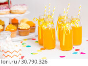 Купить «orange juice in glass bottles with paper straws», фото № 30790326, снято 6 июля 2018 г. (c) Syda Productions / Фотобанк Лори