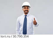 Купить «architect or businessman in helmet shows thumbs up», фото № 30790354, снято 12 января 2019 г. (c) Syda Productions / Фотобанк Лори