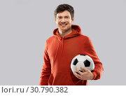 Купить «happy man or football fan with soccer ball», фото № 30790382, снято 3 февраля 2019 г. (c) Syda Productions / Фотобанк Лори
