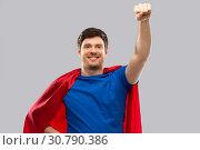 Купить «man in red superhero cape over grey background», фото № 30790386, снято 3 февраля 2019 г. (c) Syda Productions / Фотобанк Лори