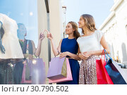 Купить «happy women with shopping bags at storefront», фото № 30790502, снято 9 августа 2015 г. (c) Syda Productions / Фотобанк Лори