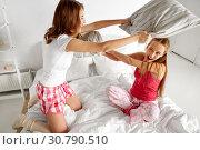 Купить «happy teen girl friends fighting pillows at home», фото № 30790510, снято 14 ноября 2015 г. (c) Syda Productions / Фотобанк Лори