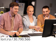Купить «business team with computer working late at office», фото № 30790566, снято 26 ноября 2017 г. (c) Syda Productions / Фотобанк Лори