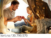 Купить «family playing tea party in kids tent at home», фото № 30790570, снято 27 января 2018 г. (c) Syda Productions / Фотобанк Лори