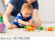 Купить «baby boy with father playing toy blocks at home», фото № 30790598, снято 5 мая 2018 г. (c) Syda Productions / Фотобанк Лори