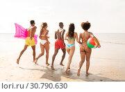 Купить «friends run with beach ball and swimming mattress», фото № 30790630, снято 29 июля 2018 г. (c) Syda Productions / Фотобанк Лори