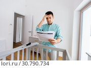 Купить «father with manual assembling baby bed at home», фото № 30790734, снято 10 февраля 2019 г. (c) Syda Productions / Фотобанк Лори