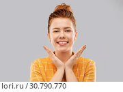 smiling red haired teenage girl in checkered shirt. Стоковое фото, фотограф Syda Productions / Фотобанк Лори