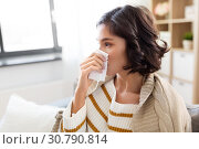 Купить «sick woman blowing nose in paper tissue at home», фото № 30790814, снято 6 марта 2019 г. (c) Syda Productions / Фотобанк Лори