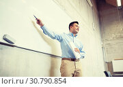 teacher pointing marker to white board at lecture. Стоковое фото, фотограф Syda Productions / Фотобанк Лори