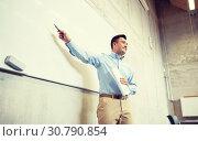 Купить «teacher pointing marker to white board at lecture», фото № 30790854, снято 19 июня 2016 г. (c) Syda Productions / Фотобанк Лори