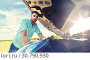 Купить «man with open hood of broken car at countryside», фото № 30790930, снято 12 июня 2016 г. (c) Syda Productions / Фотобанк Лори
