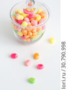 Купить «close up of glass jar with colorful candy drops», фото № 30790998, снято 6 июля 2018 г. (c) Syda Productions / Фотобанк Лори