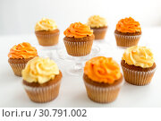 Купить «cupcakes with frosting on white background», фото № 30791002, снято 6 июля 2018 г. (c) Syda Productions / Фотобанк Лори