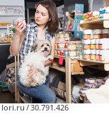 Купить «woman with dog selecting preserves», фото № 30791426, снято 7 мая 2018 г. (c) Яков Филимонов / Фотобанк Лори