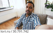 Купить «indian male blogger recording video blog at home», видеоролик № 30791742, снято 27 апреля 2019 г. (c) Syda Productions / Фотобанк Лори