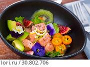 Купить «Ceviche of salmon with avocado, cumquat, kiwi fruit, figs», фото № 30802706, снято 21 октября 2019 г. (c) Яков Филимонов / Фотобанк Лори