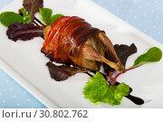 Купить «Plate with quail baked in bacon», фото № 30802762, снято 26 января 2020 г. (c) Яков Филимонов / Фотобанк Лори