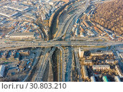 Купить «Aerial view of road junction in Moscow from above, automobile traffic and jam of many cars, road junction on the Zvenigorodskoe highway and the Third Ring Road», фото № 30803210, снято 20 ноября 2019 г. (c) Mikhail Starodubov / Фотобанк Лори