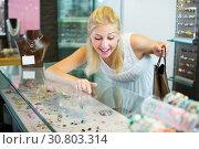 Купить «Positive girl customer looking bijouterie», фото № 30803314, снято 21 мая 2019 г. (c) Яков Филимонов / Фотобанк Лори