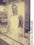 Купить «Female seller standing in jewellery boutique», фото № 30803326, снято 21 мая 2019 г. (c) Яков Филимонов / Фотобанк Лори