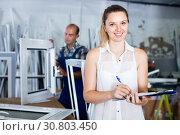 Купить «Woman manager standing with clipboard in workshop», фото № 30803450, снято 19 июля 2017 г. (c) Яков Филимонов / Фотобанк Лори