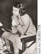 EDITORIAL Princess Elizabeth, seen here at a Coronation Concert in 1937. Princess Elizabeth of York future Elizabeth II, born 1926. Queen of the United... Редакционное фото, фотограф Classic Vision / age Fotostock / Фотобанк Лори