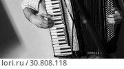 Купить «Accordionist plays vintage accordion», фото № 30808118, снято 18 мая 2019 г. (c) EugeneSergeev / Фотобанк Лори