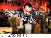 Купить «Industrious man working on belt leather», фото № 30808910, снято 21 августа 2019 г. (c) Яков Филимонов / Фотобанк Лори