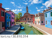 Купить «View of Burano with colorful houses and the Church of San Martino with a falling bell tower. Venice, Italy», фото № 30810314, снято 17 апреля 2017 г. (c) Наталья Волкова / Фотобанк Лори