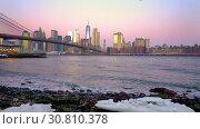 Купить «Brooklyn bridge and Manhattan at sunrise», видеоролик № 30810378, снято 15 мая 2019 г. (c) Sergey Borisov / Фотобанк Лори