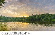 Timelapse of cloudy sunrise over forest lake. Стоковое видео, видеограф Sergey Borisov / Фотобанк Лори