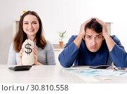 Купить «Young couple in budget planning concept», фото № 30810558, снято 22 января 2019 г. (c) Elnur / Фотобанк Лори