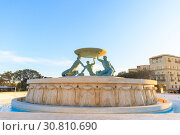 Купить «Triton Fountain at the City Gate entrance to Valletta on Malta, spring evening», фото № 30810690, снято 29 апреля 2019 г. (c) Ирина Мойсеева / Фотобанк Лори