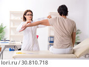 Купить «Female doctor checking patient's joint flexibility with goniometer», фото № 30810718, снято 14 января 2019 г. (c) Elnur / Фотобанк Лори