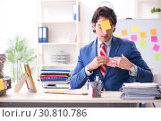 Купить «Young male handsome employee in conflicting priorities concept», фото № 30810786, снято 7 января 2019 г. (c) Elnur / Фотобанк Лори